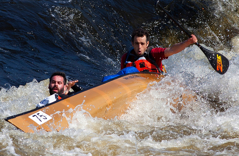 BANGOR, Maine -- 04/15/2017 -- Silas Haggerty and Joshua Prokey dump their canoe while traveling down Six Miles Falls during the 51st annual Kenduskeag Stream Canoe Race Saturday. The 16-mile race starts in Kenduskeag and ends in downtown Bangor.  Ashley L. Conti   BDN