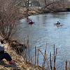 KENDUSKEAG, Maine -- 04/15/2017 -- Jodi Madore and her dog, Willy, watch as racers make their way to Bangor during the 51st annual Kenduskeag Stream Canoe Race Saturday. The 16-mile race starts in Kenduskeag and ends in downtown Bangor.  Ashley L. Conti | BDN