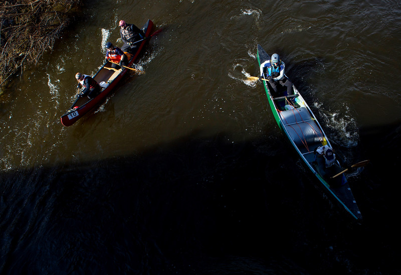 KENDUSKEAG, Maine -- 04/15/2017 -- Canoes travel under a bridge during the 51st annual Kenduskeag Stream Canoe Race Saturday. The 16-mile race starts in Kenduskeag and ends in downtown Bangor.  Ashley L. Conti | BDN