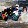 BANGOR, Maine -- 04/15/2017 -- Ben Howard, Mary Howard, and Sam Howard dump their canoe while traveling down Six Mile Falls during the 51st annual Kenduskeag Stream Canoe Race Saturday. The 16-mile race starts in Kenduskeag and ends in downtown Bangor.  Ashley L. Conti | BDN