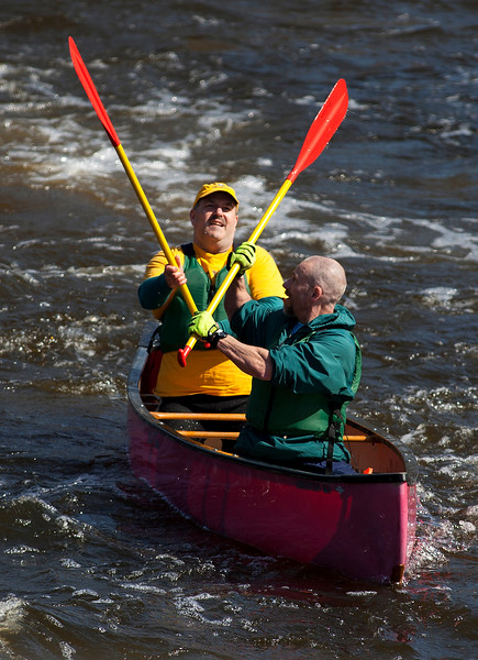 BANGOR, Maine -- 04/15/2017 -- Racers smack paddles after successfully navigating Six Mile Falls during the 51st annual Kenduskeag Stream Canoe Race Saturday. The 16-mile race starts in Kenduskeag and ends in downtown Bangor.  Ashley L. Conti | BDN