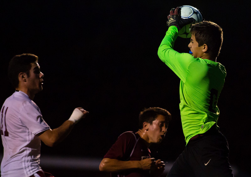 BANGOR, Maine -- 09/26/2017 - Edward Little's Noah Sterling (right) makes a save against Bangor's Kyle Jeffrey during their soccer game at Bangor Tuesday. Ashley L. Conti   BDN