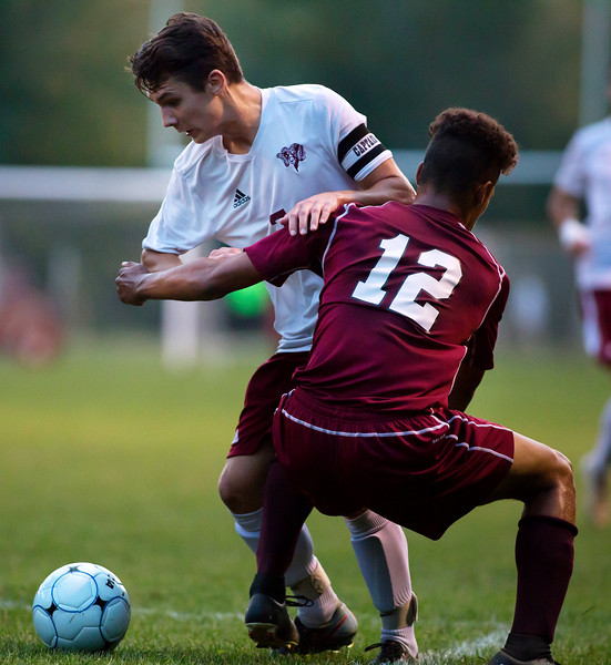 BANGOR, Maine -- 09/26/2017 - Bangor's Garth Berenyi (left) gets caught up with Edward Little's Jamaine Luizzo during their soccer game at Bangor Tuesday. Ashley L. Conti | BDN