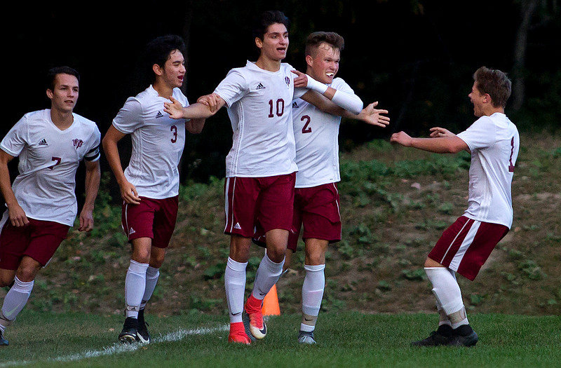BANGOR, Maine -- 09/26/2017 - Bangor's Joseph Dagher (center) celebrates with teammates after scoring a goal against Edward Little during their soccer game at Bangor Tuesday. Ashley L. Conti | BDN
