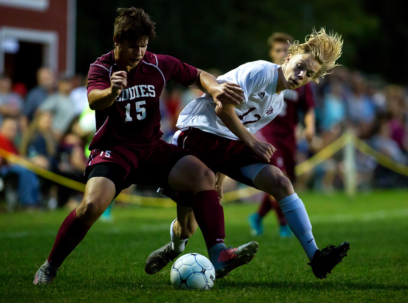 BANGOR, Maine -- 09/26/2017 - Edward Little's Spencer Frahn (left) tries to gain control of the ball against Bangor's Jacob Henry during their soccer game at Bangor Tuesday. Ashley L. Conti | BDN