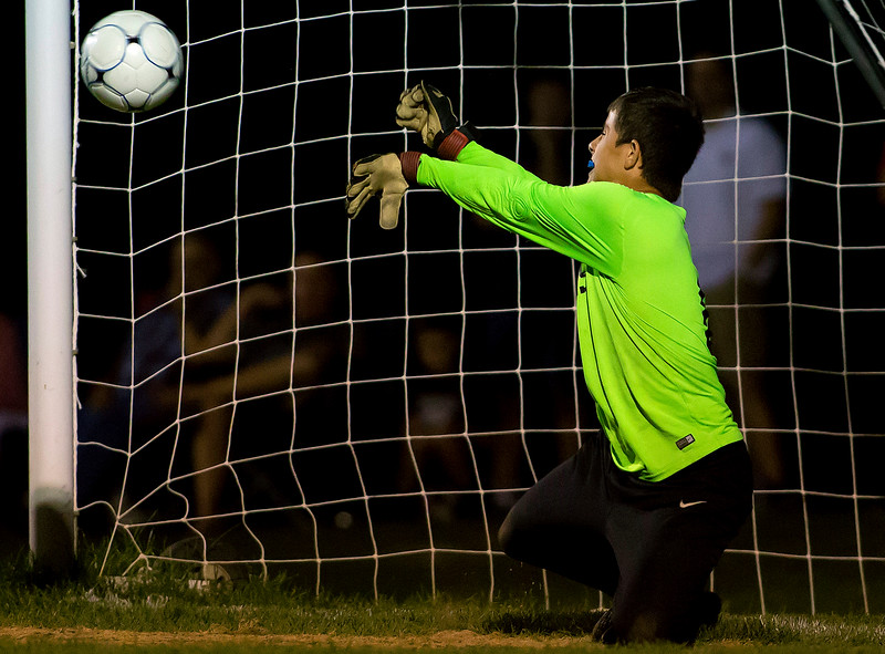 BANGOR, Maine -- 09/26/2017 - Edward Little's Noah Sterling saves a penalty kick from Bangor's Garth Berenyi during their soccer game at Bangor Tuesday. Ashley L. Conti | BDN