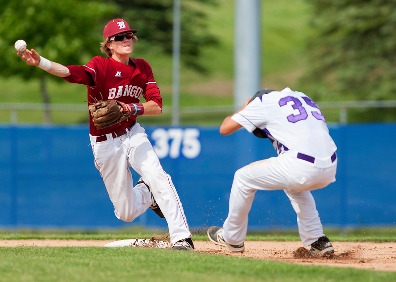BANGOR, Maine -- 06/08/2017 - Bangor's Zach Ireland (left) throws to first to try for the double play after getting Hampden Academy's Gavin Partridge slides safely back to first before can make the tag during their quarterfinal baseball game at Mansfield Stadium in Bangor. Bangor won 2-0. Ashley L. Conti | BDN