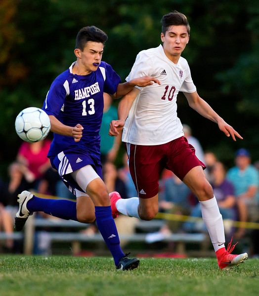 BANGOR, Maine -- 09/12/2017 - Hampden Academy's Wade Brown (left) and Bangor's Joseph Dagher battle for the ball during their soccer game at Bangor Tuesday. Ashley L. Conti | BDN