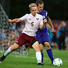 BANGOR, Maine -- 09/12/2017 - Bangor's Colin Waterman (left) and Hampden Academy's Johnny Wolfington battle for the ball during their soccer game at Bangor Tuesday. Ashley L. Conti | BDN