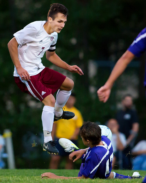 BANGOR, Maine -- 09/12/2017 - Hampden Academy's William Drake (right) makes a sliding save of a shot on goal from Bangor's Garth Berenyi during their soccer game at Bangor Tuesday. Ashley L. Conti | BDN
