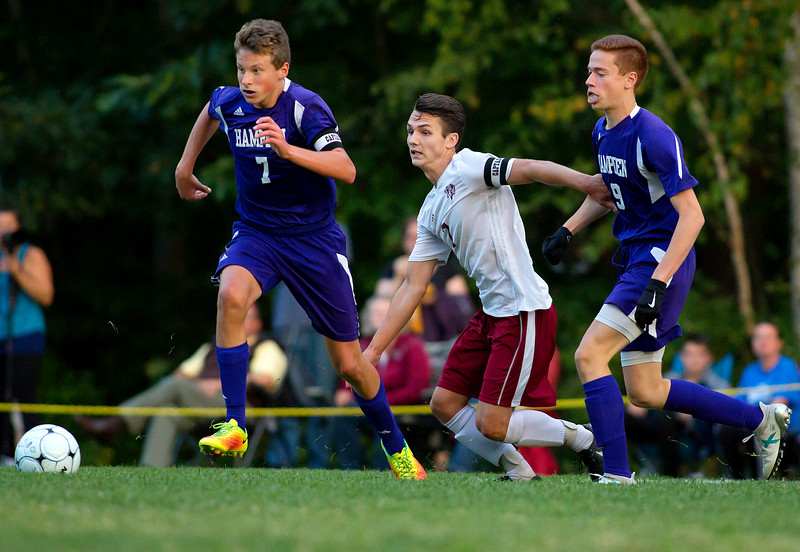 BANGOR, Maine -- 09/12/2017 - Bangor's Garth Berenyi (center) battles for a loose ball against Hampden Academy's Eliot Small (left) and Daniel Fachiol during their soccer game at Bangor Tuesday. Ashley L. Conti | BDN