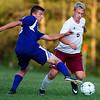 BANGOR, Maine -- 09/12/2017 - Bangor's Colin Waterman (right) tries to dribble around Hampden Academy's Derek Gendreau during their soccer game at Bangor Tuesday. Ashley L. Conti | BDN