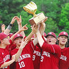 (L-R) Bangor High School (16) Karl Sund, (10) Noah Tappan (23) Nick Cowperthwaite and (22) Derek Fournier celebrate with the trophy after defeating Falmouth High School for the class A State Championship, Saturday at Fred Morton Field in Augusta. Photo by Terry Farren