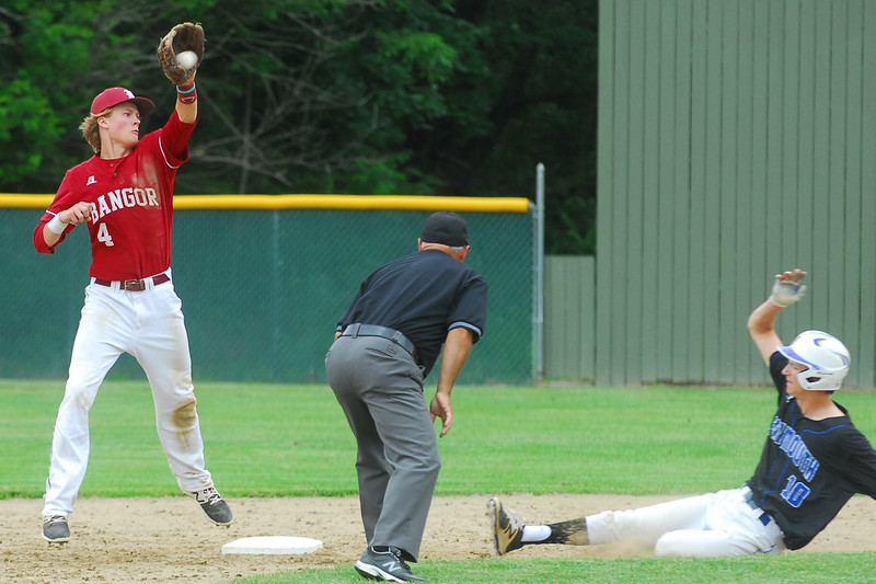 Falmouth High School (10) Max Fourtier reaches second base before being tagged out by bangor High School (4) Zach Ireland during Class A State Champion action at Fred Morton Field in Augusta Saturday. Bangor went on to defeat Falmouth in extra innings. Photo by Terry Farren
