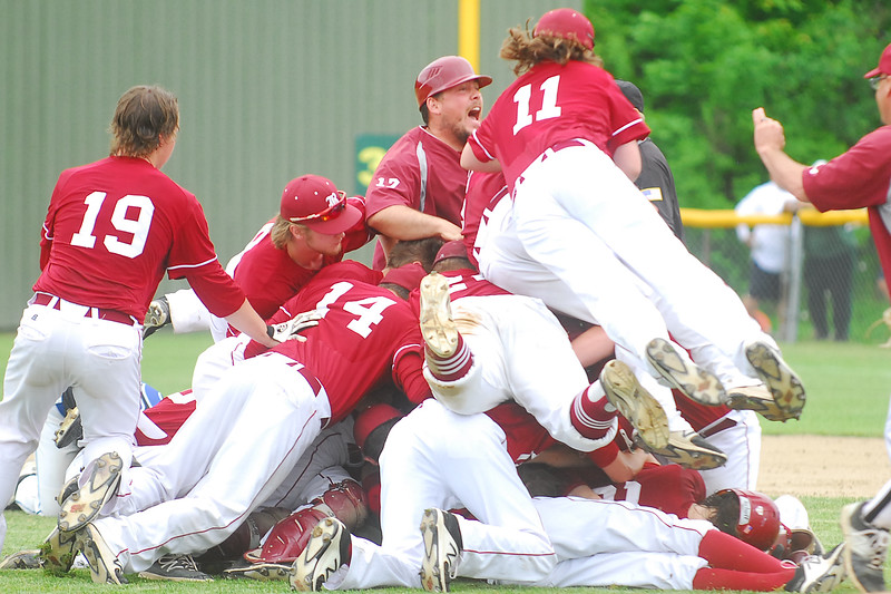 In the center Bangor High School Assistant baseball Coach, Tim Bush celebrates with the team after defeating Falmouth High School for the class A State Championship, Saturday at Fred Morton Field in Augusta. Photo by Terry Farren