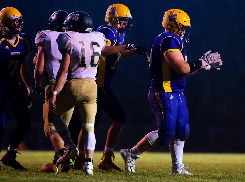 BUCKSPORT, Maine -- 09/15/2017 - Bucksport's David Gross (right) celebrates after making a tackle against Mount Desert Island during their football game at Carmichael Field in Bucksports Friday. Ashley L. Conti | BDN