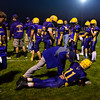 BUCKSPORT, Maine -- 09/15/2017 - Bucksport's Tyson Gray (center) gets stretched out by sports injury consultant Dr. George Skala during their football game against Mount Desert Island' at Carmichael Field in Bucksports Friday. Ashley L. Conti | BDN
