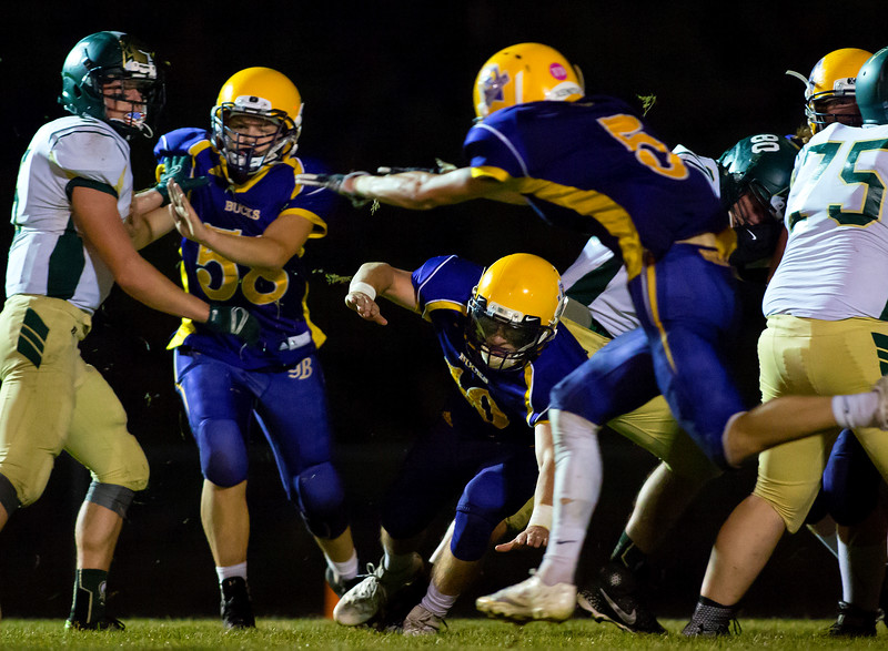 BUCKSPORT, Maine -- 09/15/2017 - Bucksport's Gavin Billings (left) and Chase Carmichael try to block a field goal attempt by Mount Desert Island during their football game at Carmichael Field in Bucksports Friday. Ashley L. Conti   BDN