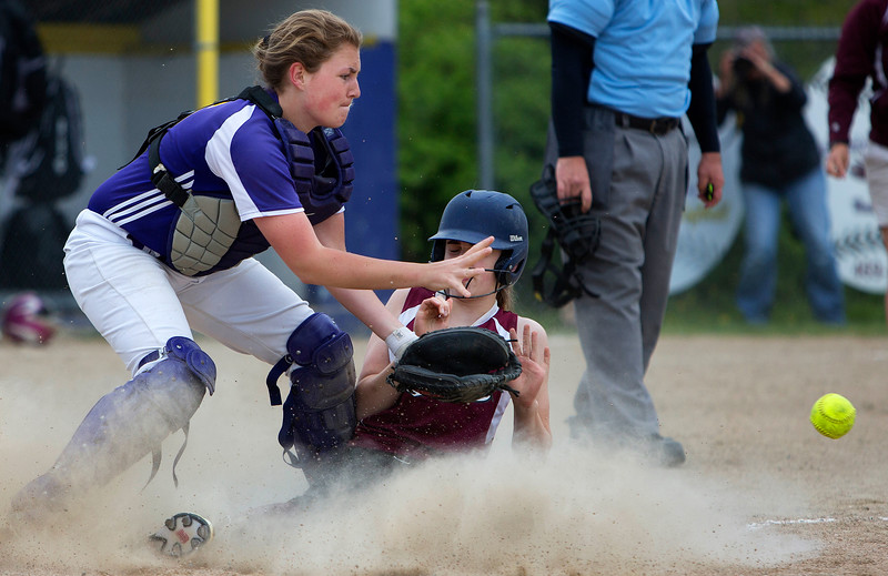 BUCKSPORT, Maine -- 05/25/2017 - Orono's Maggie Coutts (right) slides safely home past Bucksport's Makenzie Smith during their softball game in Bucksport Thursday. Ashley L. Conti | BDN