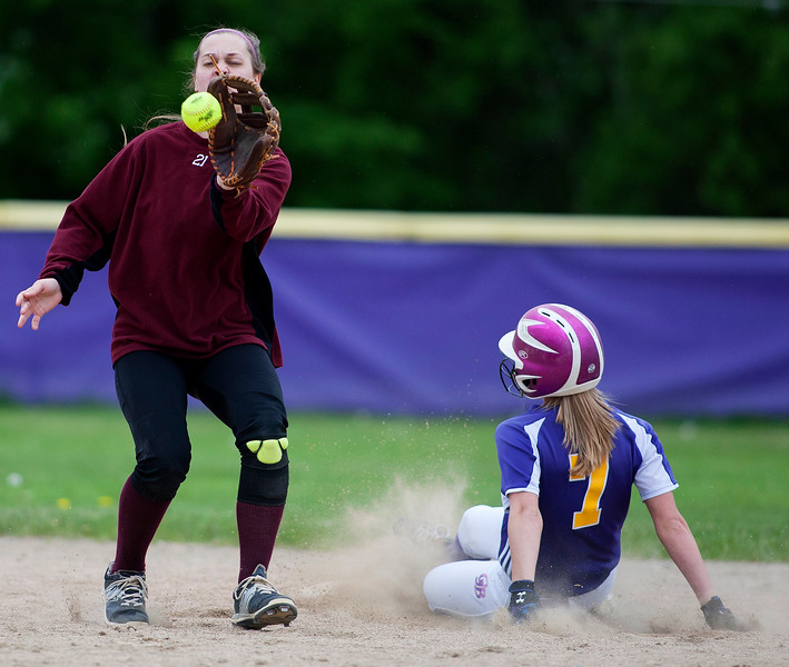 BUCKSPORT, Maine -- 05/25/2017 - Bucksport's Emily Hunt (right) slides safely to second past Orono's Katelyn Richards during their softball game in Bucksport Thursday. Ashley L. Conti | BDN