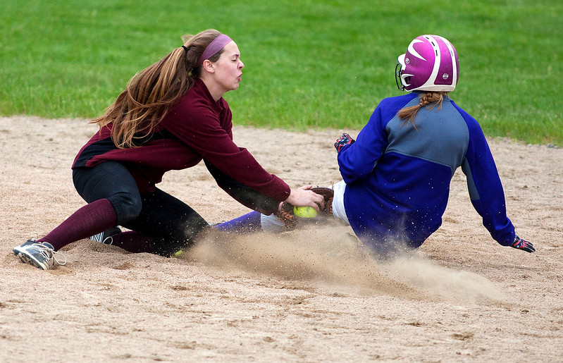 BUCKSPORT, Maine -- 05/25/2017 - Orono's Katelyn Richards (left) tags Bucksport's Hannah Ashmore out at second during their softball game in Bucksport Thursday. Ashley L. Conti | BDN
