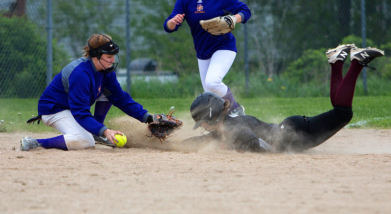 BUCKSPORT, Maine -- 05/25/2017 - Orono's Katie Walker (left) slides safely to third before Bucksport's Hannah Ashmore during their softball game in Bucksport Thursday. Ashley L. Conti | BDN