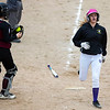 BUCKSPORT, Maine -- 05/25/2017 - Bucksport's Makayla Tripp crosses home plate for a run past Orono's Payton Trudel during their softball game in Bucksport Thursday. Ashley L. Conti | BDN