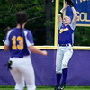 BUCKSPORT, Maine -- 05/25/2017 - Bucksport's Madysen Robichaud leaps to snag an out from Orono during their softball game in Bucksport Thursday. Ashley L. Conti | BDN