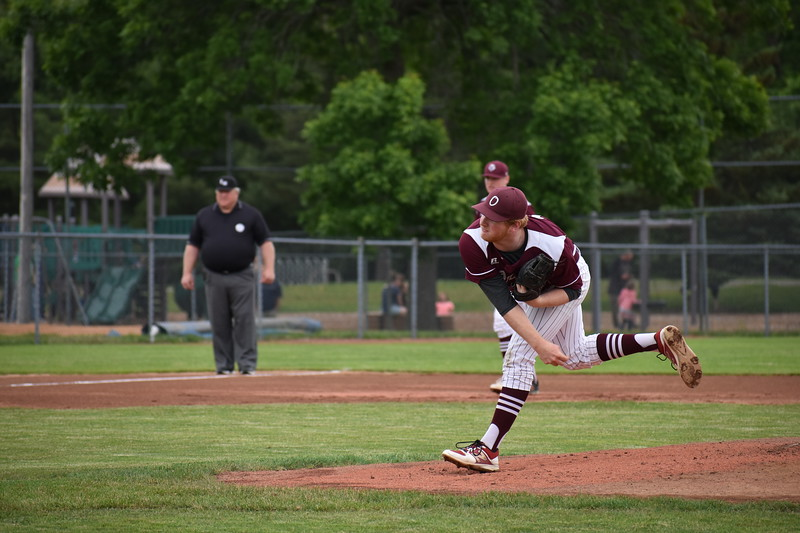 Jackson Coutts of Orono High School delivers a pitch during Saturday's Class C baseball state championship game against Lisbon at Mansfield Stadium in Bangor. The senior helped lead the Red Riots to a 4-3 victory.