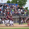 Members of the Orono High School baseball team and their fans celebrate after Connor McCluskey scored the winning run to cap a four-run, seventh-inning rally to beat Lisbon 4-3 in the Class C baseball state championship game at Mansfield Stadium in Bangor on Saturday.