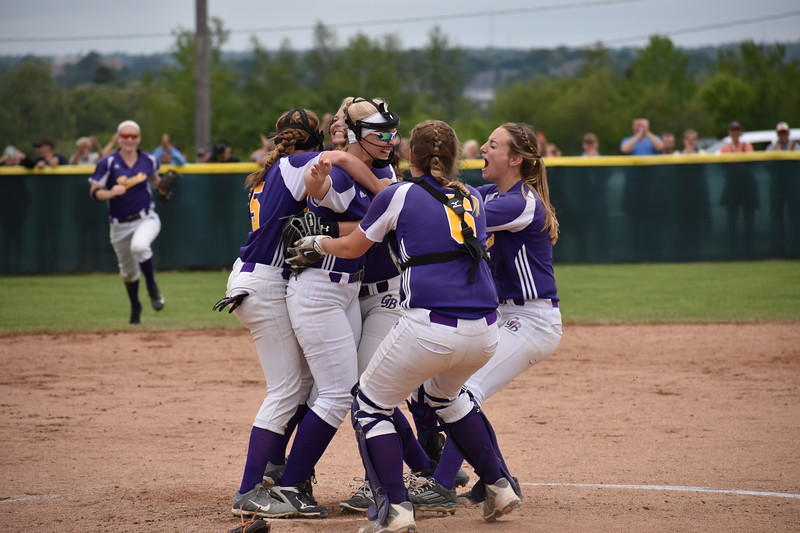 A celebration erupts in the pitcher's circle on Saturday as Bucksport clinches its 2-1 Class C softball state championship victory over Madison at Coffin Field in Brewer.