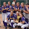 The members of the Bucksport High School softball team pose with the gold glove emblematic of a state championship after edging Madison 2-1 in the Class C title game at Coffin Field in Brewer.