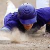 DEXTER, Maine -- 06/02/2017 - Bucksport's Jake Ames dives safely back to first before Dexter's Matt Hanscome can make the tag during their baseball game in Dexter Friday. Ashley L. Conti | BDN