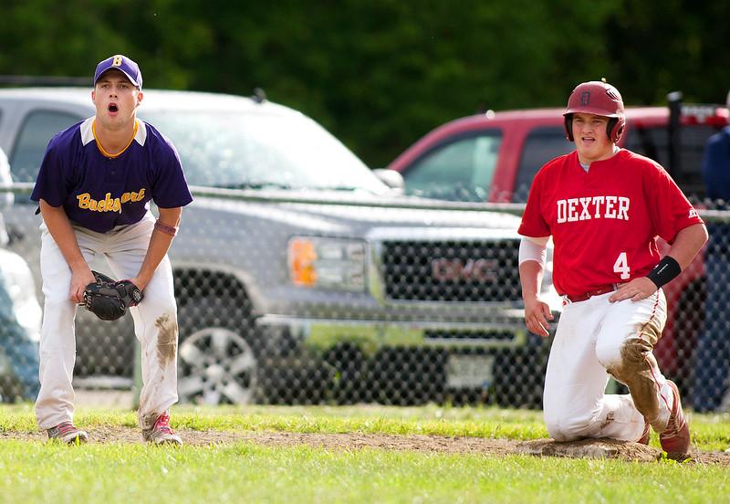 DEXTER, Maine -- 06/02/2017 - Bucksport's Matt Vincent (left) reacts after Dexter's Brayden Miller was called safe at third during their baseball game in Dexter Friday. Ashley L. Conti | BDN