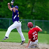DEXTER, Maine -- 06/02/2017 - Bucksport's Andy Allan (left) leaps to snag the ball to get Dexter's Zach White out at second during their baseball game in Dexter Friday. Ashley L. Conti | BDN