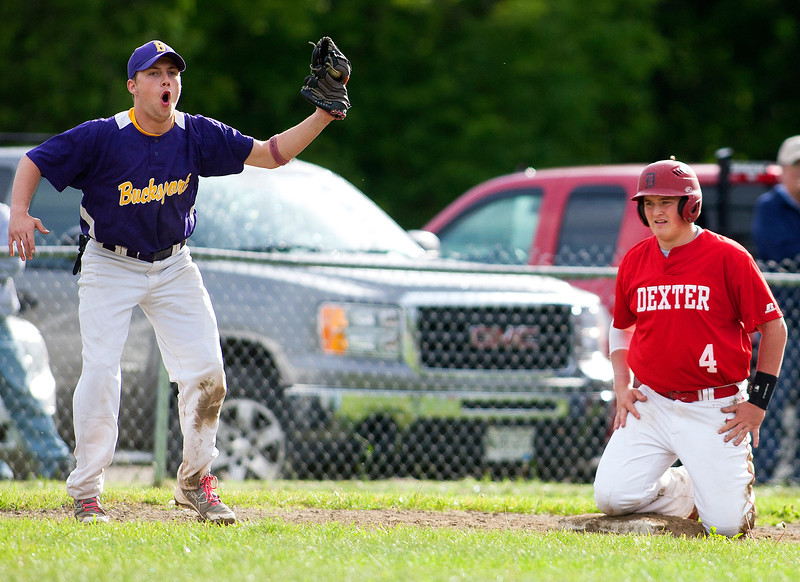 DEXTER, Maine -- 06/02/2017 - Bucksport's Matt Vincent (left) reacts after Dexter's Brayden Miller was called safe at third during their baseball game in Dexter Friday. Ashley L. Conti | BDN