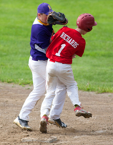 DEXTER, Maine -- 06/02/2017 - Dexter's Nathan Richards (left) successfully makes it to first before Bucksport's Jake Ames can make the tag during their baseball game in Dexter Friday. Ashley L. Conti | BDN