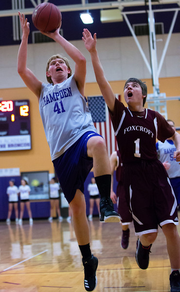 HAMPDEN, Maine -- 03/09/2017 -- Hampden Academy's Kyle Prim (left) tries for two past Foxcroft Academy's Virginia Macomber during their Unified basketball game at Hampden Academy Thursday. Hampden won. Ashley L. Conti | BDN