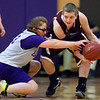 HAMPDEN, Maine -- 03/09/2017 -- Hampden Academy's Madison Mooers (left) and Foxcroft Academy's Gabe Taylor battle for loose ball during their Unified basketball game at Hampden Academy Thursday. Hampden won. Ashley L. Conti | BDN