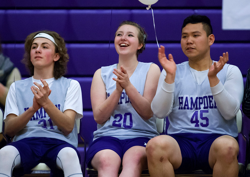 HAMPDEN, Maine -- 03/09/2017 -- Hampden Academy's Joshua Stebbins (from left), Josephine Trojecki, and Paniehan Rithburi cheer on their team while they take on Foxcroft Academy during their Unified basketball game at Hampden Academy Thursday. Hampden won. Ashley L. Conti | BDN