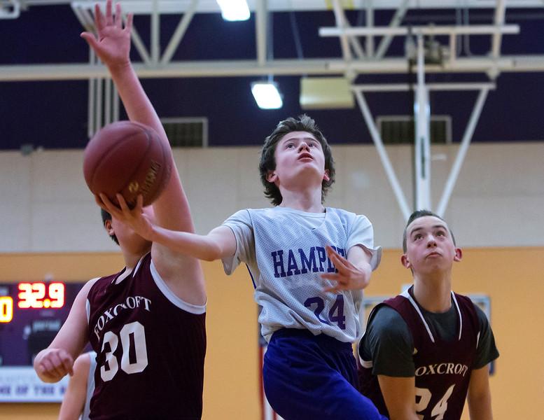 HAMPDEN, Maine -- 03/09/2017 -- Hampden Academy's Jaron Baude (center) goes up for two past Foxcroft Academy's Austin McKenna (left) and Riley Poisson during their Unified basketball game at Hampden Academy Thursday. Hampden won. Ashley L. Conti | BDN