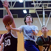HAMPDEN, Maine -- 03/09/2017 -- Hampden Academy's Jaron Baude (center) goes up for two past Foxcroft Academy's Austin McKenna (left) and Riley Poisson during their Unified basketball game at Hampden Academy Thursday. Hampden won. Ashley L. Conti | BDN