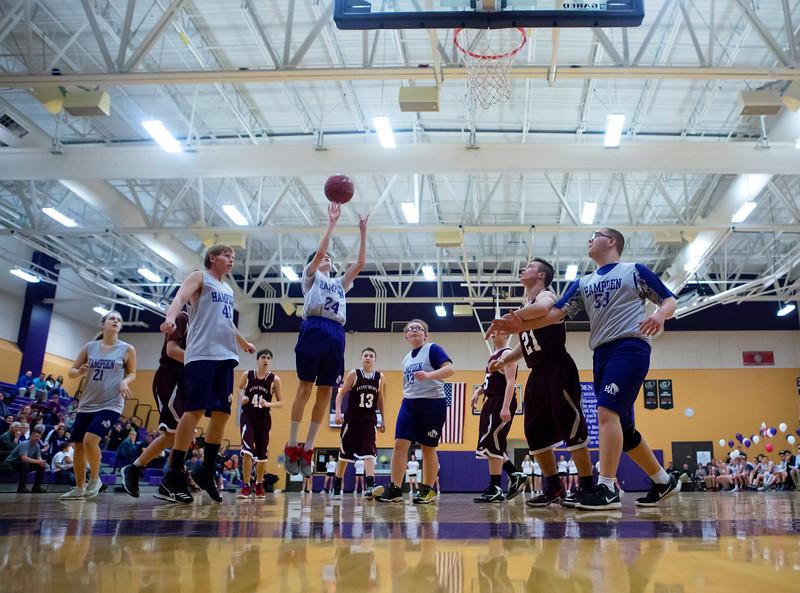 HAMPDEN, Maine -- 03/09/2017 -- Hampden Academy's Isaiah Palmer (center) puts up a shot past Foxcroft Academy during their Unified basketball game at Hampden Academy Thursday. Hampden won. Ashley L. Conti | BDN
