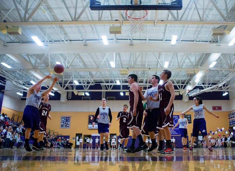HAMPDEN, Maine -- 03/09/2017 -- Hampden Academy's Zachary Ewing (left) tries for two past Foxcroft Academy during their Unified basketball game at Hampden Academy Thursday. Hampden won. Ashley L. Conti | BDN