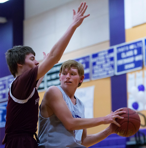 HAMPDEN, Maine -- 03/09/2017 -- Hampden Academy's Kyle Prim (right) looks to pass around Foxcroft Academy's Virginia Macomber during their Unified basketball game at Hampden Academy Thursday. Hampden won. Ashley L. Conti | BDN