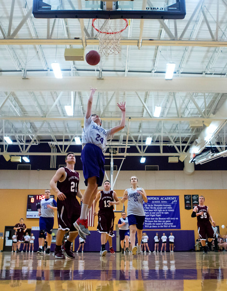 HAMPDEN, Maine -- 03/09/2017 -- Hampden Academy's Jaron Baude (center) floats up for two past Foxcroft Academy's Coy Cooley during their Unified basketball game at Hampden Academy Thursday. Hampden won. Ashley L. Conti | BDN