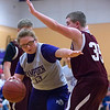 HAMPDEN, Maine -- 03/09/2017 -- Hampden Academy's Madison Mooers (left) drives the lane past Foxcroft Academy's Gabe Taylor during their Unified basketball game at Hampden Academy Thursday. Hampden won. Ashley L. Conti | BDN