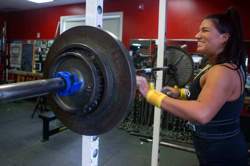 BANGOR, Maine -- 11/03/2016 -- Jade Socoby laughs with another athlete before squatting at Union Street Athletics in Bangor Thursday. Socoby used powerlifting to lose over 100 pounds. Ashley L. Conti | BDN