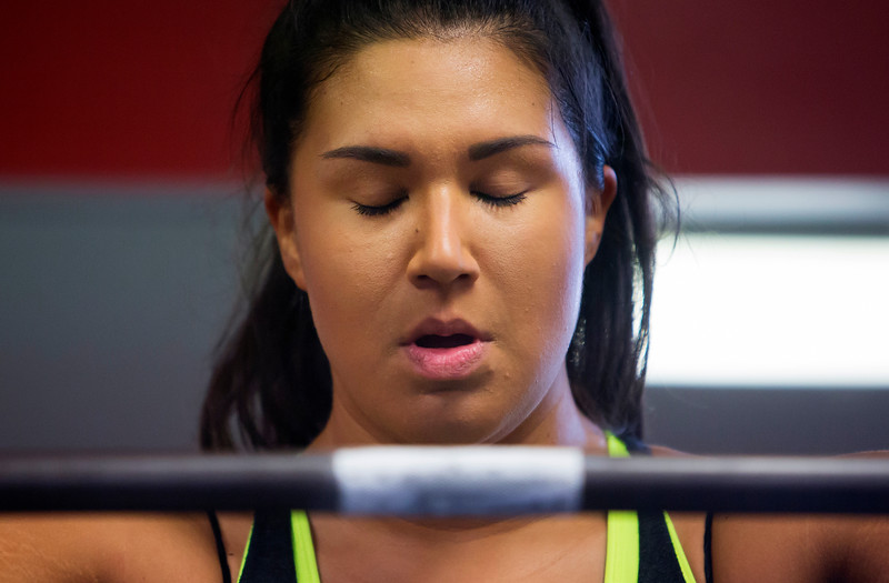 BANGOR, Maine -- 11/03/2016 -- Jade Socoby takes a moment to regain composure before doing a squat workout at Union Street Athletics in Bangor Thursday. Socoby used powerlifting to lose over 100 pounds. Ashley L. Conti | BDN