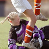 madawaska goalie Liz Laplante (?  no number) makes a close save under the trampling feet of NYA  Megan Meintel, 16, in the first half of their championship game on Saturday.<br /> york photo    york photo